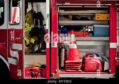 Fire fighting equipment on display inside a fire truck - Stock Photo
