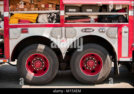 Fire fighting equipment inside a fire truck on display - Stock Photo