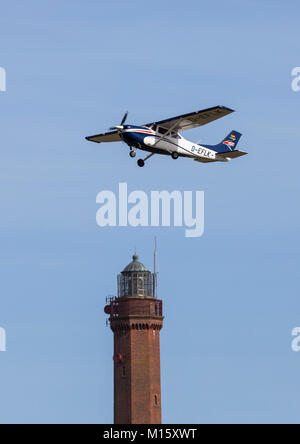 The East Frisian North Sea island Norderney, Germany, winter, lighthouse at the airport, plane - Stock Photo