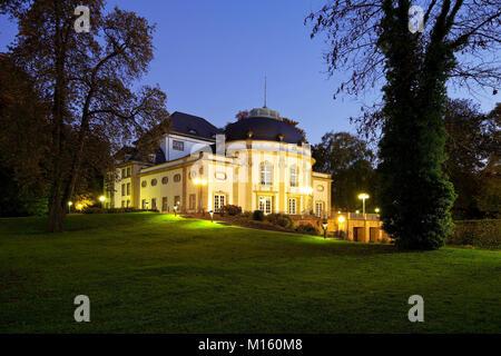 Illuminated theatre in the park in the blue hour,spa garden,Bad Oeynhausen,Ostwestfalen-Lippe,North Rhine-Westphalia