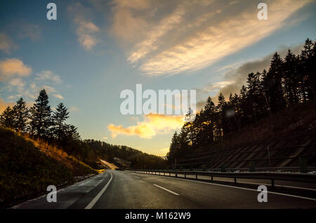 Beautiful sunset view along the road from Asahikawa to Sapporo, Hokkaido's largest city. Driving in Hokkaido is - Stock Photo