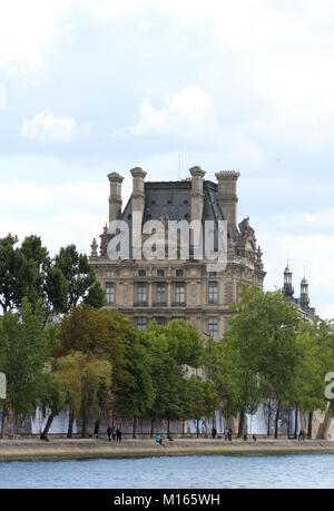 View of Louvre Museum from the Seine river, Paris, France. - Stock Photo