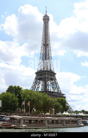 A Trimaran Parisian / Pierre Bellon boat and view of Eiffel Tower from the Seine River, Paris, France. - Stock Photo