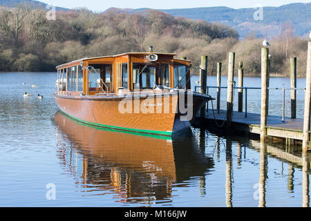 The motor cruiser 'Lakeland Mist' tied up at the landings on Derwent water near Keswick - Stock Photo