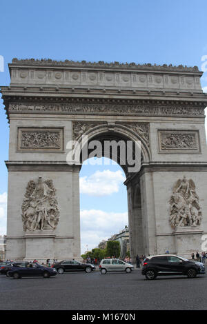 The Arc de Triomphe de l'Etoile, the Triumphal Arc from the front with cars passing on the street, Paris, France. - Stock Photo
