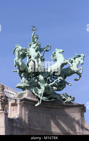 Quadriga statue on the top of the Grand Palais called Immortality Outstripping Time by Georges Recipon, Paris, France. - Stock Photo