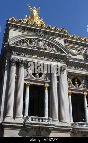 Golden statue, reliefs and other decorations on the top left corner of the front of the Palais Garnier opera house, - Stock Photo