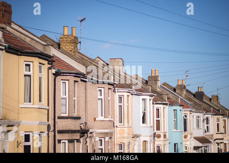 Multi-coloured terraced housing in residential area - Stock Photo
