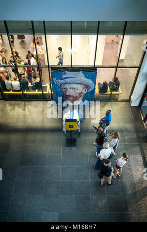 People waiting to take their photo with the Van Gogh autoportrait, Amsterdam, Netherlands - Stock Photo