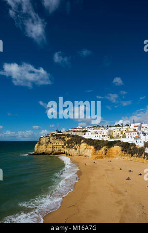 Bay with beach and colourful houses, Carvoeiro, Algarve, Portugal - Stock Photo