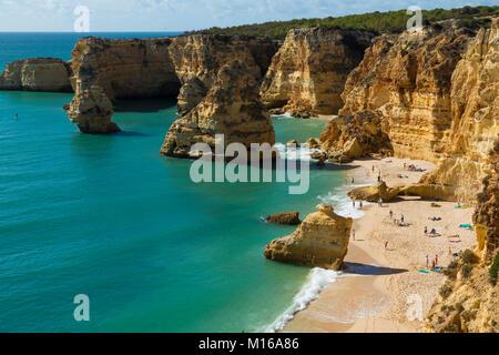 Beach and coloured rocks, Praia da Marinha, Carvoeiro, Algarve, Portugal - Stock Photo