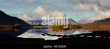 The view across Loch Leven from Glencoe Village on a cold November morning with the hills of Ardgour wrapped in - Stock Photo