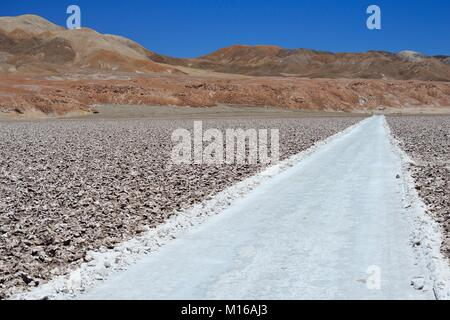 Road through Salzfeld, Salar de Atacama, near San Pedro de Atacama, Región de Antofagasta, Chile - Stock Photo
