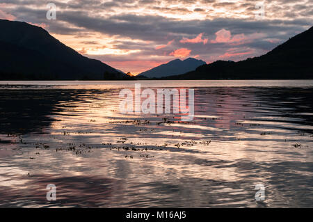 Late September sunset from the beach at Invercoe, near Glencoe, Scotland, looking out across Loch Leven and Loch - Stock Photo