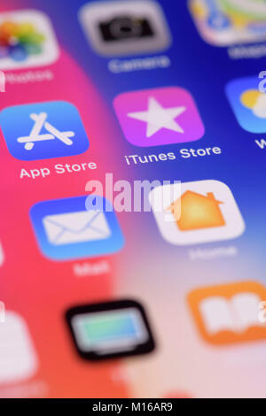 Apple iPhone X, large screen smartphone, closeup on desktop with app icons on the display, studio shot - Stock Photo