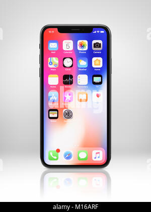 Apple iPhone X, large screen smartphone, with desktop and app icons on its display, studio shot - Stock Photo