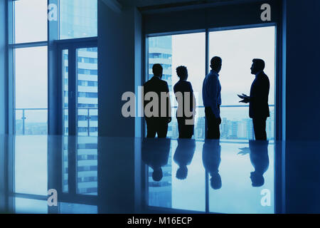 Office concept with employees silhouettes against big window - Stock Photo