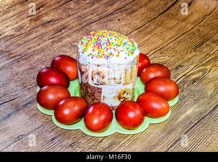 Easter cake and painted red Easter eggs. Food for the Easter table. - Stock Photo