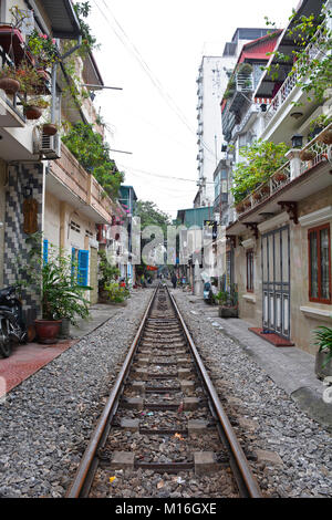 Hanoi, Vietnam - 14th December 2017. A residential street often referred to as Train Street in central Hanoi which - Stock Photo