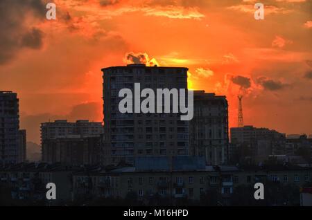 Baku, Azerbaijan, on a sunny summer day. Buildings at sunset, just the horizon show colorful night Azerbaijan Baku. - Stock Photo