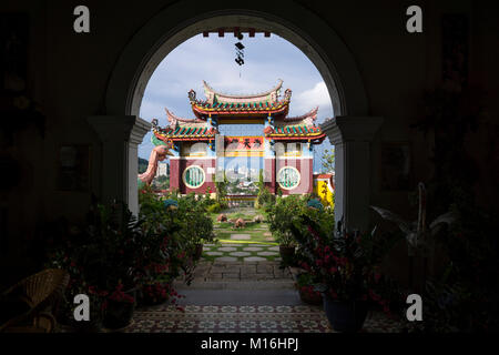 Arch at Kek Lok Si temple overlooking temple and skyline of Georgetown, Penang, Malaysia - Stock Photo
