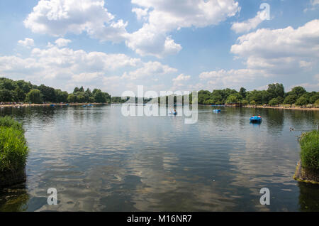 Boats on the Serpentine at Hyde Park on a summer's day, London, England - Stock Photo