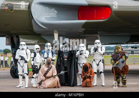 Characters from Star Wars pose beside the Vulcan Bomber at the RNAS Yeovilton International Air Day, UK on 11/7/15. - Stock Photo