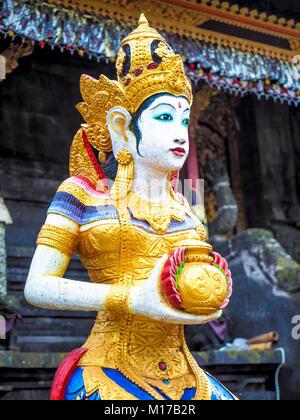 Colourful Hindu goddess figurine in Pura Ulun Danu Batur Temple in Bali - Stock Photo
