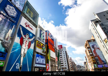 (27 January 2018, Dotonbori, Osaka, Japan) Colourful Signboards from Ebisu bridge on Dotonbori canal - Stock Photo