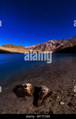 Feet in the lake, a couple of stones forming a feet in the Chadratal lake - Stock Photo