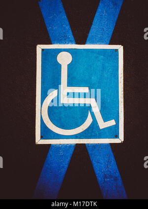 Pictogram handicapped parking on pavement - Stock Photo