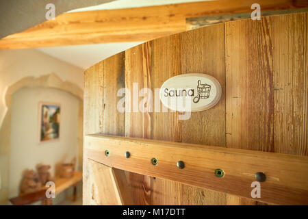 spa, relaxation and healthcare in finnish wooden sauna room - Stock Photo