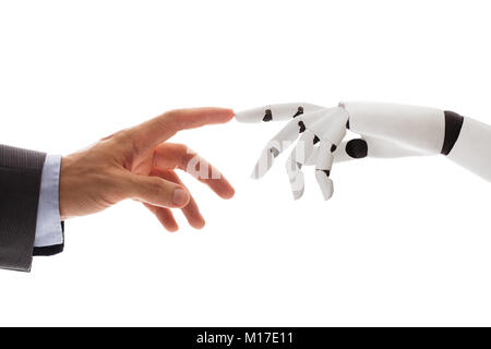 Close-up Of Businessperson Finger Touching Robotic Finger Over White Background - Stock Photo