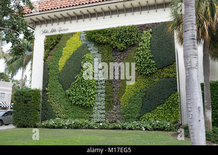 Beautiful floral wall at the side of the Saks Fifth Avenue building in Palm Beach Florida at Worth and South County - Stock Photo