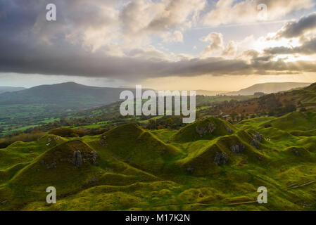 Morning light breaks through the clouds over the iconic  Llangattock Escarpment in the Usk Valley above Crickhowell - Stock Photo