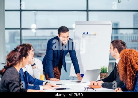 Successful business presentation of man at office - Stock Photo