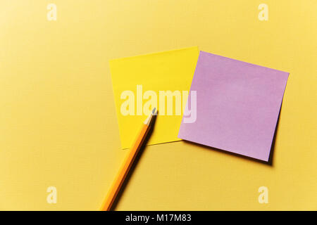 stickers for recording and pencil on yellow background. - Stock Photo