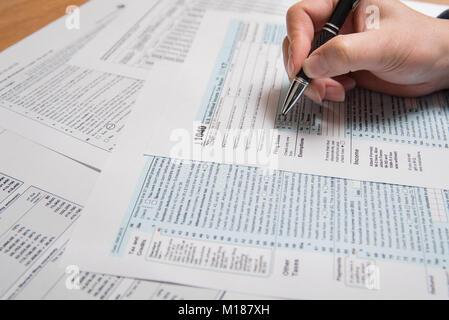 Usa Tax Form 1040 Man Filling Us Tax Form Home Economics Concept