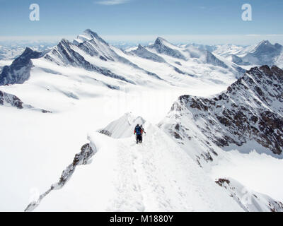 two climbers on Mönch descent with panorama view - Stock Photo