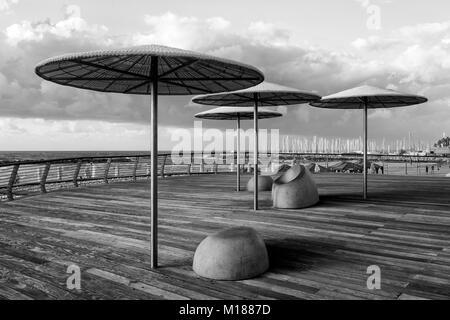 TEL AVIV, ISRAEL - December 26, 2016: Modern beach promenade with umbrellas and relax seat in Tel Aviv, Israel - Stock Photo