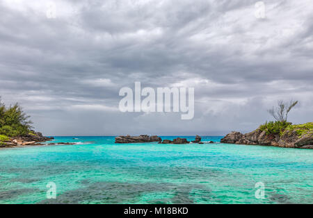 Storm Clouds over Tobacco Bay Beach in St. George's Bermuda - Stock Photo