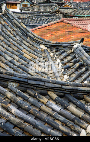 General view of Korean traditional roofs in Seoul old town. Korean traditional roofs made by slate. - Stock Photo