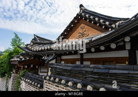 General view of Korean traditional houses (hanok) in Seoul old town. Korean traditional roofs made by slate and - Stock Photo