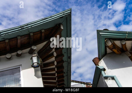 Closed view of Korean traditional roofs in Seoul old town. Korean traditional roofs made by slate. - Stock Photo