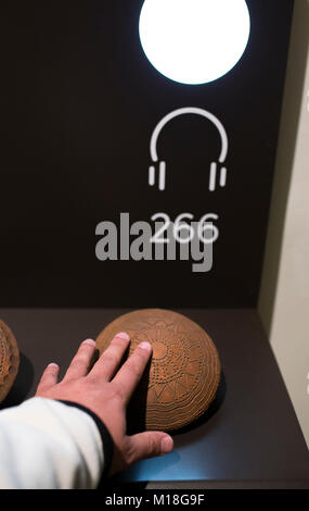 Madrid, Spain - November 11, 2017: Tactile display. Blind visitor touching a neolithic pottery replica at National - Stock Photo