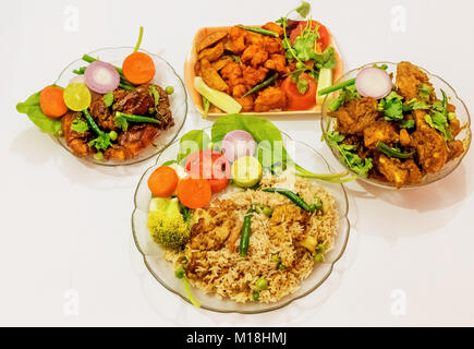 Spicy Indian non vegetarian food comprising of fried rice, deep fried spicy prawn, chicken boneless fry and chicken - Stock Photo