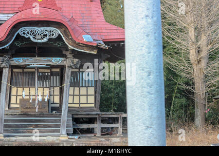 (16, January, 2016, Namie, Fukushima, Japan) A local small shrine leaning to one side and left alone due to Earthquake - Stock Photo