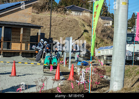 (16, January, 2016, Namie, Fukushima, Japan) Decontamination workers were cleaning contaminated land. Reconstruction - Stock Photo