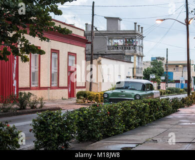 Holguin, Cuba - August 31, 2017: Retro American classic car parked on the side street. - Stock Photo