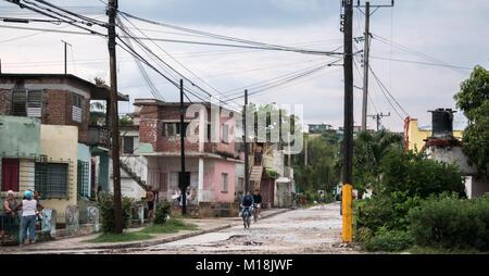Holguin, Cuba - August 31, 2017: Local Cubans outside on a residential street. - Stock Photo